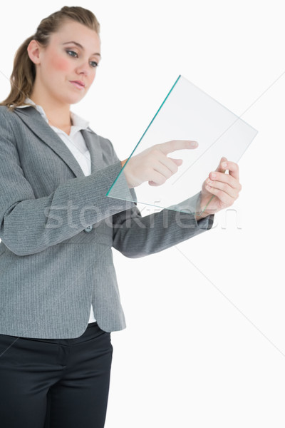Businesswoman pointing at something on the pane attentively Stock photo © wavebreak_media