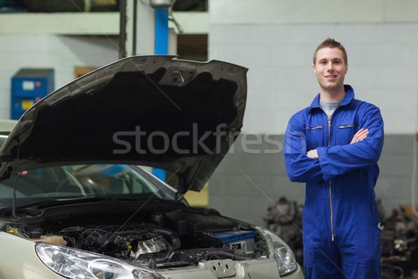 Confident mechanic standing by car Stock photo © wavebreak_media