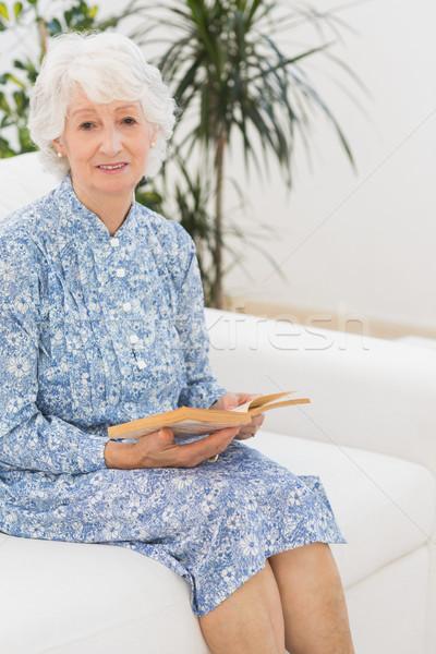 Elderly woman reading a old novel Stock photo © wavebreak_media