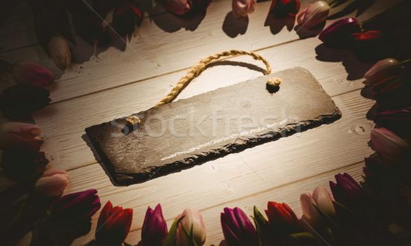 Vintage image of tulips forming frame around chalkboard Stock photo © wavebreak_media