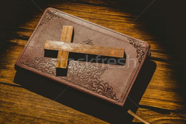 Crucifix icon on the bible Stock photo © wavebreak_media