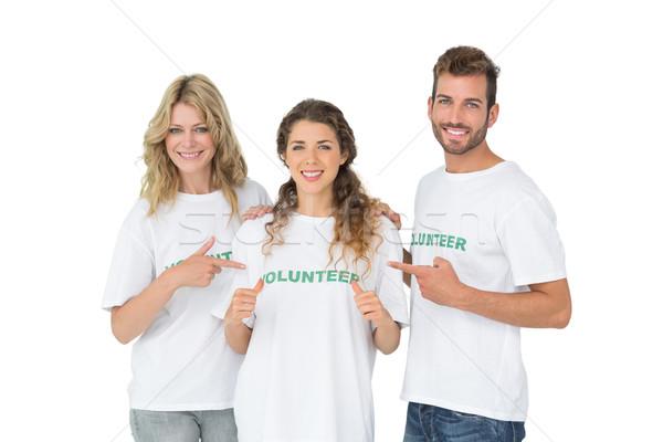 Portret gelukkig vrijwilligers wijzend vriend witte Stockfoto © wavebreak_media