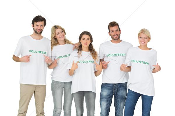 Gruppo ritratto felice volontari punta uomo Foto d'archivio © wavebreak_media