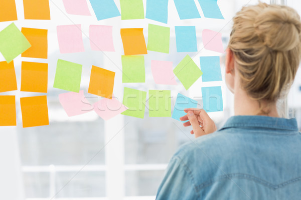 Rear view of a female artist looking at colorful sticky notes Stock photo © wavebreak_media
