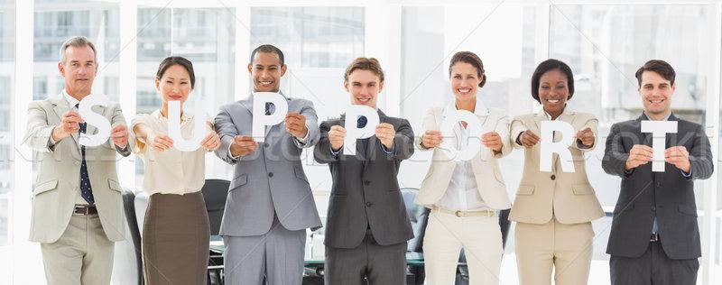Diverso equipo de negocios cartas ortografía apoyo Foto stock © wavebreak_media