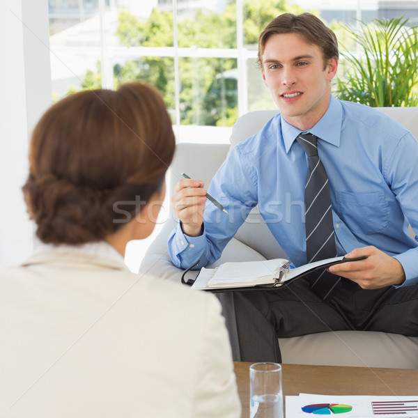 Young businessman scheduling with colleague sitting on couch Stock photo © wavebreak_media