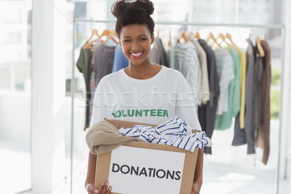 笑みを浮かべて 若い女性 服 寄付 肖像 幸せ ストックフォト © wavebreak_media