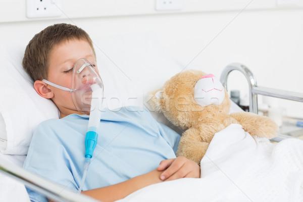 Boy wearing oxygen mask sleeping beside teddy bear Stock photo © wavebreak_media