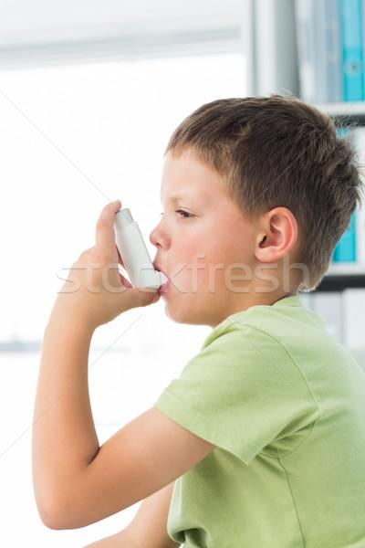 Boy using asthma inhaler in hospital Stock photo © wavebreak_media