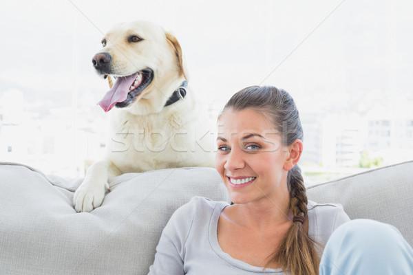 счастливым женщину позируют желтый Лабрадор диване Сток-фото © wavebreak_media