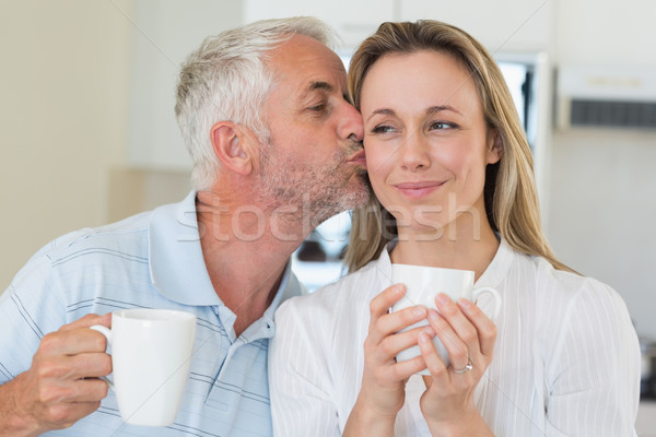 Smiling man giving his partner a kiss on the cheek Stock photo © wavebreak_media