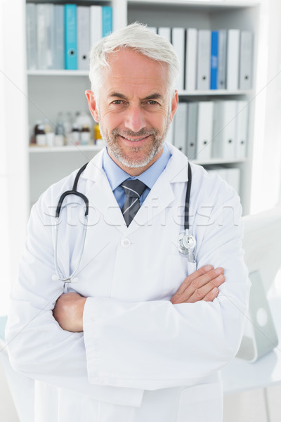Portrait of a smiling confident male doctor at medical office Stock photo © wavebreak_media