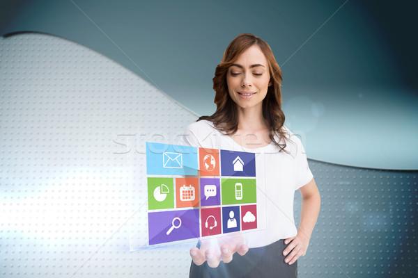 Smiling businesswoman showing app menu Stock photo © wavebreak_media