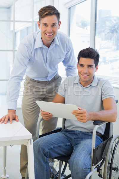Toevallig zakenman rolstoel glimlachend camera collega Stockfoto © wavebreak_media