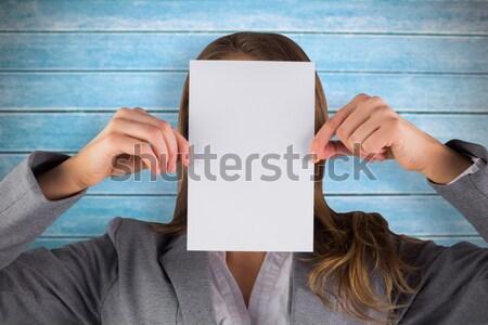 Businesswoman showing a blank card Stock photo © wavebreak_media