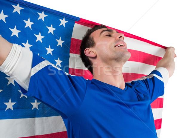 American soccer fan holding flag Stock photo © wavebreak_media