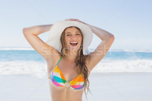 красивая девушка пляж улыбаясь белый соломенной шляпе Бикини Сток-фото © wavebreak_media