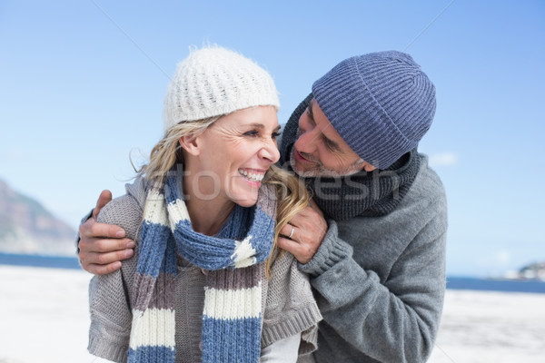 Atraente casal praia agasalhos brilhante Foto stock © wavebreak_media