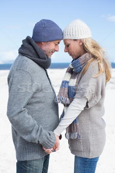 Vonzó pár áll tengerpart meleg ruha fényes Stock fotó © wavebreak_media