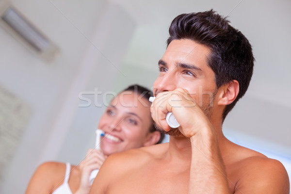 Attractive couple brushing their teeth in the morning Stock photo © wavebreak_media