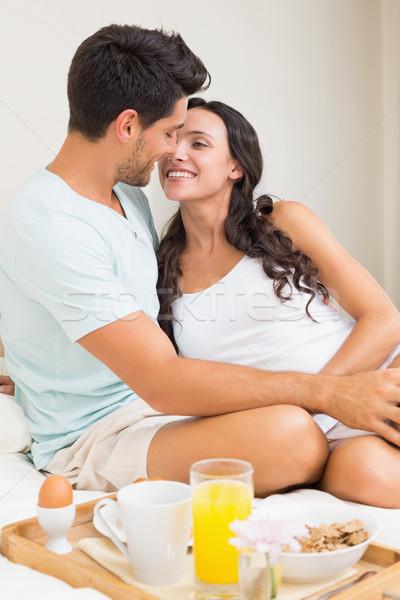 Aantrekkelijk paar ontbijt bed home slaapkamer Stockfoto © wavebreak_media