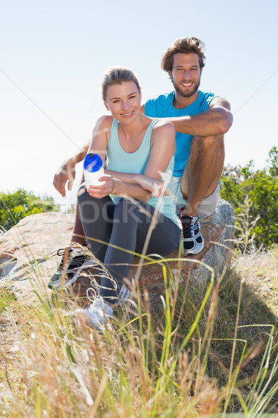 Fit couple taking a break at summit smiling at camera Stock photo © wavebreak_media