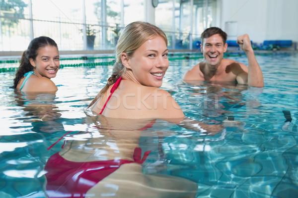 Fitness class doing aqua aerobics on exercise bikes Stock photo © wavebreak_media