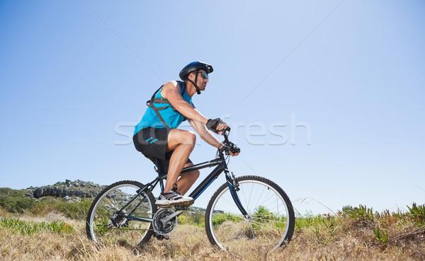 S'adapter cycliste équitation campagne montagne Photo stock © wavebreak_media
