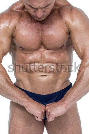 Mid section of a shirtless muscular man in gym Stock photo © wavebreak_media