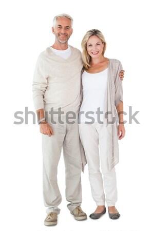 Happy couple smiling at camera together Stock photo © wavebreak_media