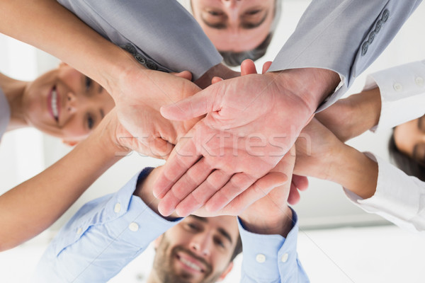 Four workers stacking hands together Stock photo © wavebreak_media