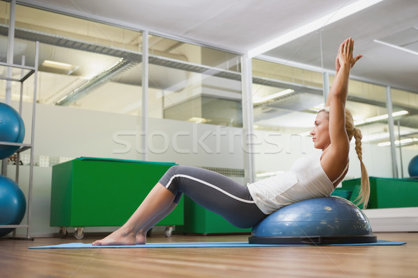 Side view of woman doing fitness exercise in fitness studio Stock photo © wavebreak_media