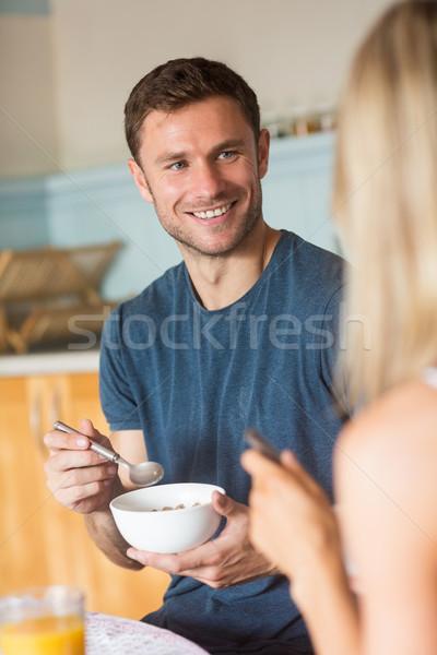 Cute couple having cereal for breakfast Stock photo © wavebreak_media