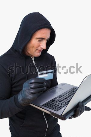 Burglar with balaclava hacking a laptop Stock photo © wavebreak_media