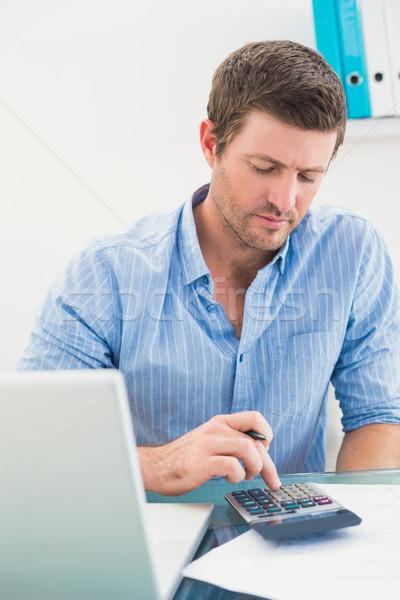 A businessman working on his finances at his desk Stock photo © wavebreak_media
