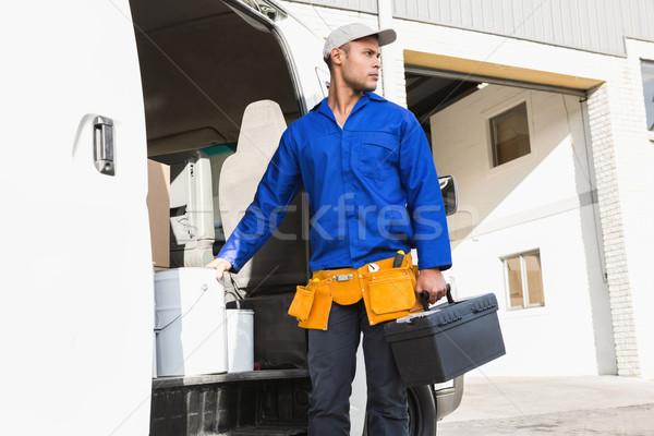 Sério bonito handyman caixa de ferramentas tem Foto stock © wavebreak_media