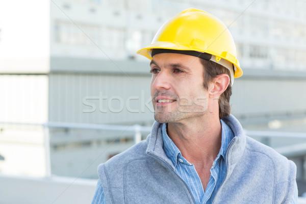 Thoughtful architect wearing yellow hard hat Stock photo © wavebreak_media