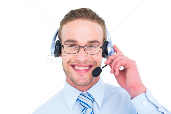 Smiling businessman with headset interacting Stock photo © wavebreak_media