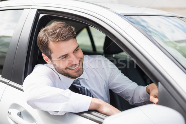 Businessman sitting in drivers seat Stock photo © wavebreak_media