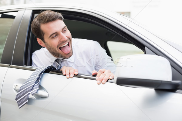 Carefree businessman sitting in drivers seat Stock photo © wavebreak_media