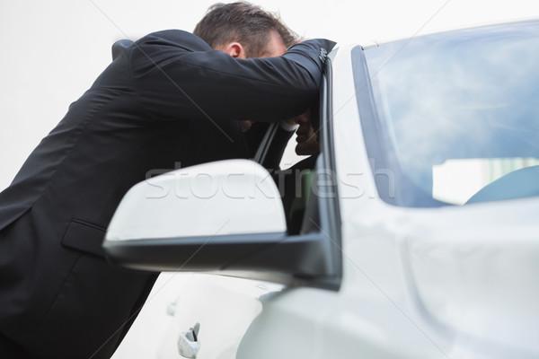 Businessman looking inside the car Stock photo © wavebreak_media