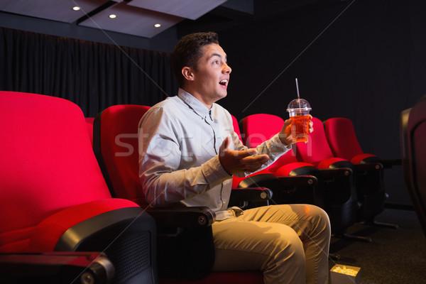 Fiatalember néz film mozi film szék Stock fotó © wavebreak_media