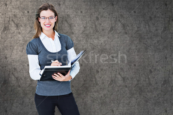 Composite image of happy woman writing in diary  Stock photo © wavebreak_media