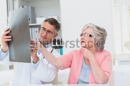 Nurse helping senior patient in exercising with resistance band Stock photo © wavebreak_media