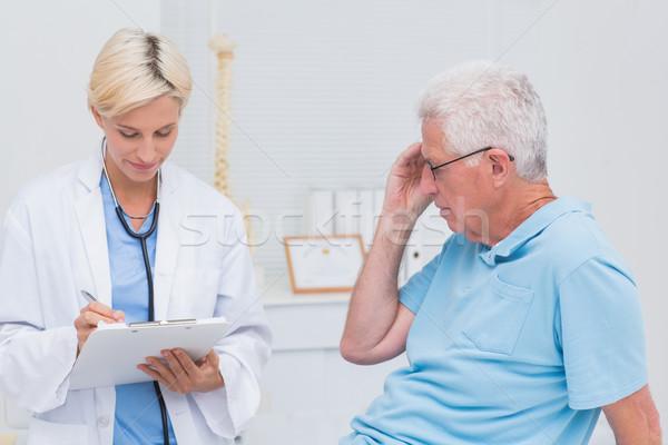 Doctor writing prescription for senior patient Stock photo © wavebreak_media