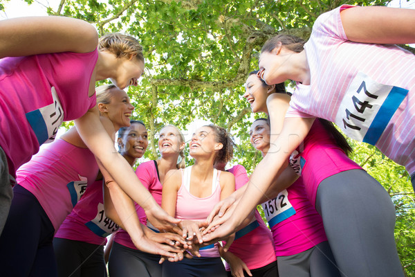 Souriant femmes courir cancer du sein conscience Photo stock © wavebreak_media