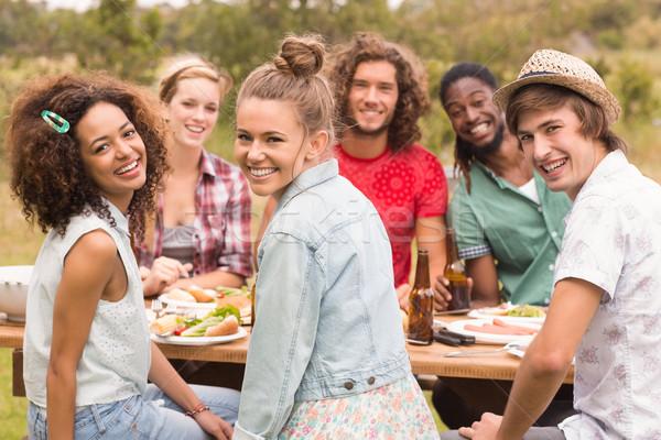 Happy friends in the park having lunch Stock photo © wavebreak_media