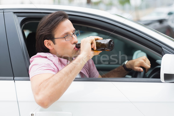 Stok fotoğraf: Adam · içme · bira · sürücü · araba · şişe