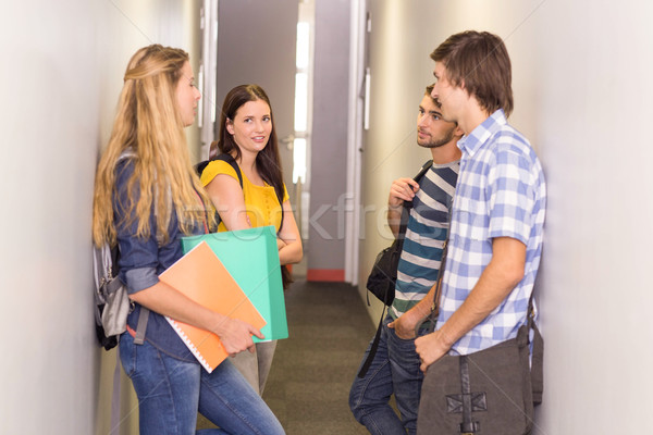 Students with files standing at college corridor Stock photo © wavebreak_media