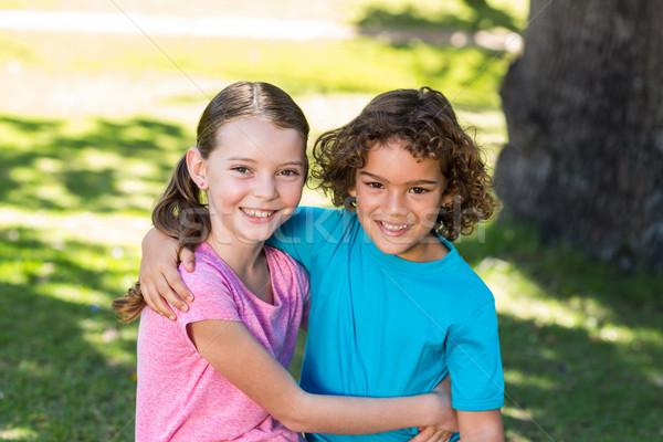 Little siblings smiling at camera Stock photo © wavebreak_media